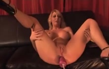 Busty blonde fucking her ass and pussy with a machine