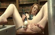 Redhead machine fucked in the library